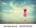 happy woman jumping and holding ... | Shutterstock . vector #462910102