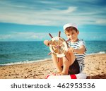 boy playing at the beach in... | Shutterstock . vector #462953536