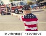 Boy Watching A Firetruck Drive...