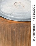 Small photo of Rusty garbage can