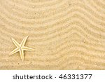 A Starfish On Sand With Many...