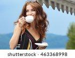 Woman Drinking Coffee In Hotel...