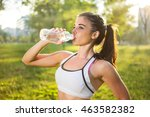 young smiling woman drinking... | Shutterstock . vector #463582382