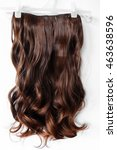 long curly brown wig on a white ... | Shutterstock . vector #463638596