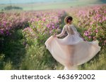 Stock photo beautiful woman in a floral park garden roses makeup hair a wreath of roses long wedding dress 463692002