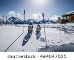snowshoes and hiking sticks... | Shutterstock . vector #464047025