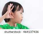 Small photo of portrait of a little asian girl suffers from hearing impairment, hard of hearing, hearing loss, acoustic or ear problem, deafness with text space