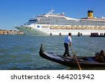 Small photo of Venice, Italy - May 13, 2013: Gondola & huge cruise ship in Giudecca Canal. Many people affirm that the environmental impact of big cruise ships on the old town is unsustainable for the fragile city.