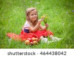 beautiful little girl picking... | Shutterstock . vector #464438042