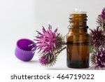 Small photo of bottle with burdock (castor, agrimony) oil, agrimony branch