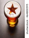 Star Symbol On Foam In Glass On ...
