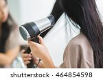 Woman With A Hair Dryer To Hea...
