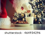 hand of santa claus picking... | Shutterstock . vector #464934296