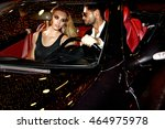 couple in luxury car. night...   Shutterstock . vector #464975978