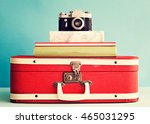 Vintage Photo Camera Over Books ...