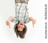 little boy hanging upside down | Shutterstock . vector #465062618