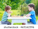 two boys playing chess outdoors.... | Shutterstock . vector #465162596