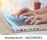 woman typing on laptop keyboard ... | Shutterstock . vector #465240392