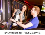 young couple on slot machine in ... | Shutterstock . vector #465263948