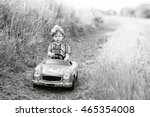 Stock photo little preschool kid boy driving big toy car and having fun with playing outdoors child enjoying 465354008