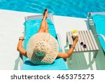 woman relaxing at the poolside... | Shutterstock . vector #465375275