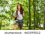 Happy Woman Hiking In The Woods
