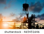 Small photo of Silhouette People heavy industrial sector construction worker, plans to comply with the planning engineers on the scaffolding over blurred background pastel. Heavy industry and safety at work concept.