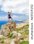 Small photo of Success climbing and achievement, running or hiking accomplishment. Man celebrating with arms up outstretched in mountains, climbing rocky trail path outdoors. Motivation and inspiration concept.
