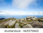 man standing on rock... | Shutterstock . vector #465570602