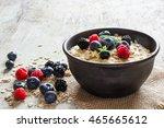 oatmeal porridge with berries... | Shutterstock . vector #465665612
