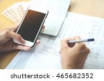 man working at office holding a ...   Shutterstock . vector #465682352