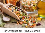wooden scoop and mixed legumes | Shutterstock . vector #465981986