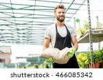 handsome gardener with apron... | Shutterstock . vector #466085342
