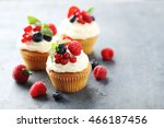 tasty cupcakes with berries on...