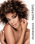 Small photo of Beauty closeup portrait of young african american girl with afro. Girl looking at camera. Ideal skin.