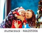 happy mother hugging her ... | Shutterstock . vector #466205306