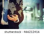 businessman holding phone | Shutterstock . vector #466212416