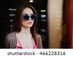 girl in shop chooses optical... | Shutterstock . vector #466228316