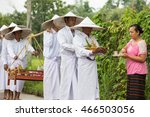 Small photo of MAE SOT, TAK, THAILAND - AUGUST 10, 2016 : Row of white men are walking receive offering to the lord of Buddha at Ban Tha Aad, Mae Sot, Tak, Thailand