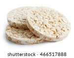 Pile of three puffed rice cakes isolated on white.