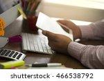 man works on digital tablete.   Shutterstock . vector #466538792