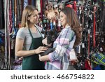 Stock photo saleswoman looking at female customer carrying french bulldog 466754822