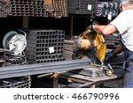 Worker Cutting Iron Bars