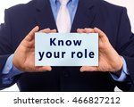 Small photo of Business man hold paper know your role text on it