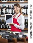 saleswoman showing blank tablet ... | Shutterstock . vector #466981742