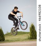 teenager jump on a bicycle... | Shutterstock . vector #466982108