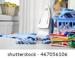 clothes in plastic basket with... | Shutterstock . vector #467056106