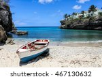 Small Fishing Boat On Shore Of...