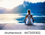 young woman meditating by the... | Shutterstock . vector #467205302