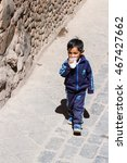 Small photo of Pisac, Peru - May 15: Young boy walking dressed up in full Adidas clothing in the Sacred Valley Market. May 15 2016, Pisac Peru.